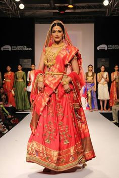 Red, but not so red. Great colour for a pretty bridal lehenga!