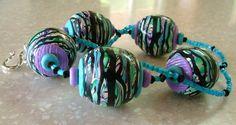 Polymer Clay Necklace Stroppel Cane. $57.00, via Etsy.