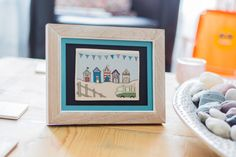 Eye catching beach hut wall plaque (with frame) - perfect for adding a touch of the South West to any home.