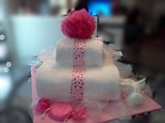 Square Spa cake, has 2 x face towels, 2 hand towels, 2 x bath towels, 3oz candy disc fizzy, and bath salt All wrapped in cello with matching ribbon. Customize for your graduation, mothers day, birthday center piece. Dish Towel Crafts, Dish Towels, Hand Towels, Spa Cake, Towel Cakes, Bridal Shower Cakes, Face Towel, Graduation Ideas, Basket Ideas
