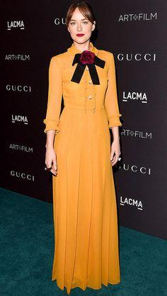Dakota Johnson in a mustard yellow Gucci dress