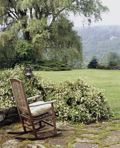 OK, so the room is outdoors, but it has a floor of flagstone, a comfy rocker, and incredible view of the lush Berkshire landscape.  Add a footstool and it would be perfect!
