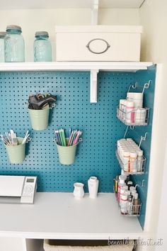 craft closet makeover. like the wire baskets to hold paints on peg board...paint the ugly brown!