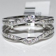 I think this looks cool and I'd put a round diamond in the middle. However I think I would turn the bands of tiny diamonds into solid white gold. -cm Enhancer Ring Guard: this would make a simple band really stand out! Double Wedding Bands, Wrap Wedding Band, Diamond Wedding Bands, Wedding Jewelry, Wedding Rings, Ring Guard, Vintage Engagement Rings, Solitaire Engagement, Engagement Sets