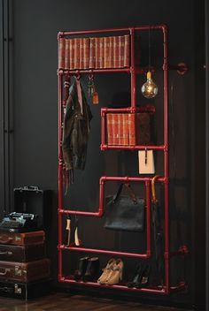 Variety pipe rack for books and clothing made with Kee Klamp pipe fittings.