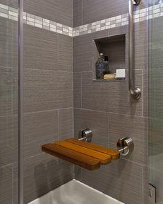 Fold down teak bench. Slab front cabinets. Maple. Frameless shower enclosure. Shower Niche. Shower pan. Grab Bar. Hand shower