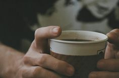 His finger tapped the rim of the cup rapidly, his foot jerking in time under the table.