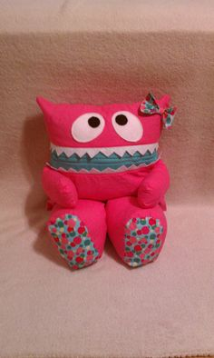 Hot Pink Pajama Eater Pillow Pal Monster with Teal Polka Dot Feet and Bow.