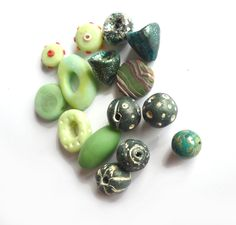 green beads  set of 15 beads bulk beads mix of orphan green handmade beads washers charms mixed sizes and shapes -  Instant collection chifonie handmade beads polymer clay beads green beads beads for bracelets beads for necklace dark green beads light green beads set of green beads DIY beads mixed beads green emerald bulk beads set 14.00 EUR #goriani