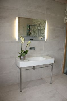 Mirror Wall Cabinet. Illuminated mirror wall cabinet and wall mounted mixer tap. Copyright The Designer Knowledge.