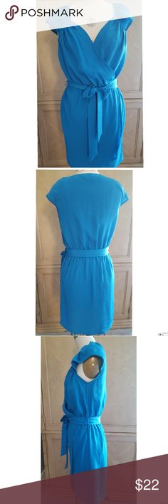 """BEBE DRESS Pretty BEBE Faux Wrap Dress in Blue. Shirring design around front neck, Elastic waist with sash to tie. NWOT, Never worn. - 100% polyester  - Hand Wash - Approximately 35"""" from shoulder to hem BEBE Dresses Mini"""