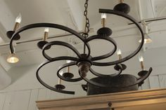 Griffin Chandelier by #GabbyDecor  The lower profile of the Griffin Chandelier makes it the perfect piece to add a dramatic touch to spaces with low ceilings. Spiral shaped Rusty Black finished iron arms extend to support eight candle lights on this elegant, spiral chandelier. This item is UL approved.
