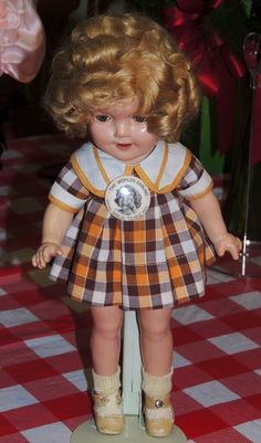 This my oldest Shirley Temple doll and my favorite. She is 80 years old. Her dress I tagged and her pin and every thing is original