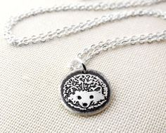 Tiny hedgehog necklace in silver (Etsy)