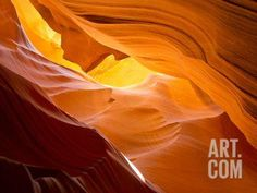 Sunlight Streams Through Cracks in a Slot Canyon Photographic Print by Mike Theiss at Art.com