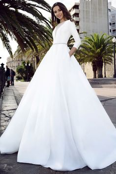 Exquisite Tulle & Satin Bateau Neckline A-line Wedding Dress With Beadings & Pockets