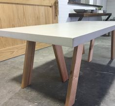 """Introducing our new Tripod Dining Table - polished concrete top w/ solid tassie oak legs made by the talented @blackhoneycustom ••••••••••••••••••••••••••…"""