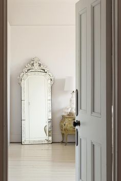 So glam-French to just set a chic mirror on the painted floor. ZsaZsa Bellagio