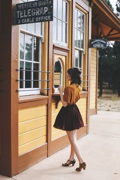 Mustard yellow blouse, burgundy skirt, and floral print t-straps.
