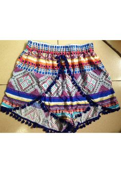 Vintage-inspired Dolphin - Shorts. These Aztec vintage shorts have an elastic waistband, pom pom ball hemline.