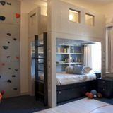 Climbing wall in Park Avenue sports-themed kids room  by design company Perianth