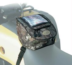 This Tank Top Bag easily adjusts to fit securely on ATV s. The tank top position is great for keeping gear close at hand, inside the large padded and lined compartment.