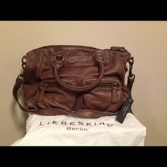 Liebeskind Purse Brand new Liebeskind Purse. Comes with dust bag. Has a long strap that could be used as a cross body. Also has small straps. Tons of pockets to put things. Liebeskind Bags