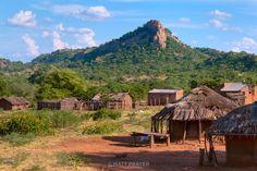 A rocky outcrop rises above a village in the Tete Corridor, Mozambique