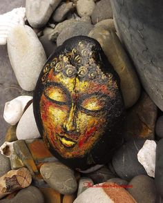"""""""The Golden Buddha"""" is a piece that never fails to share tranquility and strength at the same time...really grateful for what that rock has transformed into #buddharocks #gardendecoration #paintedrock #buddhaart #rockpaint #art_on_rocks #stillstanding #tranquility #meditation #stoneart #goldenbuddha #uwillneverknow #stonepainting #beautifulrock #meditationrock #zen #zengarden #buddhism #gold #sona #loverock #paintedstones"""