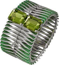 """CARTIER. """"Double Jeu"""" Bracelet – or gris, deux péridots rectangle à pans coupés pour 64,59 carats, grenats tsavorite, diamants taille brillant. Ces deux bracelets peuvent être portés ensemble ou séparément. #Cartier #CartierMagicien #HauteJoaillerie #FineJewelry #Peridot #Tsavorite #Diamond"""