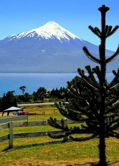 Osorno, Chile with view of Osorno Volcano Beautiful Places To Visit, Wonderful Places, Sur Chile, Places Around The World, Around The Worlds, South American Countries, Vacation Spots, Beautiful Landscapes, The Great Outdoors