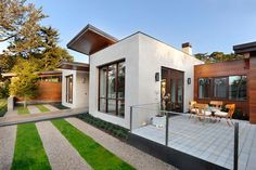 Modern Green Home with Smooth Pool and Mini Golf Course