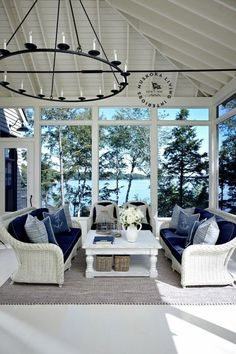 Coastal Homes: 52 Ideas. Like the use of the darker blue. And the wall of windows without any treatments just makes the room.