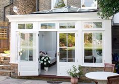 022 Orangery in Clapham, London opens up back of house for family living area White conservatory