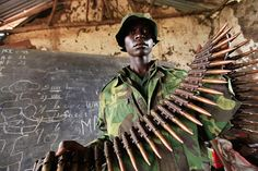 Bunagana, Democratic Republic Of Congo: A Congolese rebel fighter shows arms captured from fleeing the Congolese army in a town they overran near the Uganda borderPhotograph: James Akena/Reuters