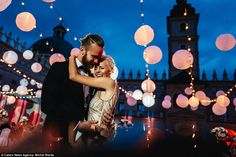 A pair of newlyweds embrace after saying their 'I dos' in this pic snapped by Michal Warda...