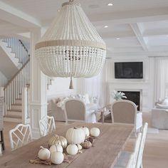 @JSHOMEDESIGN- Fall decor, ro sham beaux chandelier, neutral decor, neutral living room, ballard design dayna chairs , white pumpkins