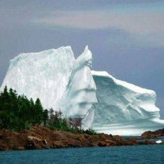 Salvage Bay, Newfoundland, an iceberg.                              …