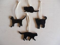 SALE -- Unique Set of Four (4) Handmade Stoneware BLACK CAT Silhouette Ornaments on Etsy, $20.00