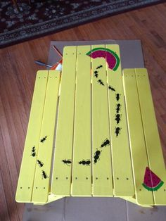 PRE-K 3 painted this charming kid-size picnic table with ants made out of fingerprints. Join us at the Bulldog Bash and place your bid! Painted Picnic Tables, Kids Picnic Table, Picnic Time, Painted Chairs, Painted Furniture, Home Furniture, Picnic Table Paint, Outdoor Projects, Wood Projects