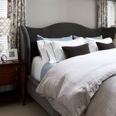 Comfy luxe master. Love the bed. And colors.