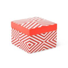 """Secret Treasure: There are a million things you can stash in this not-even-3""""-tall porcelain box, but we think the bright color lends itself best to your favorite candies."""