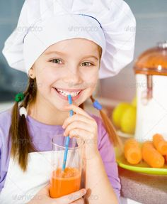 Buy girl making fresh juice by on PhotoDune. smily little girl drink a fresh carrot juice Citrus Juicer, Carrots, Author, Stock Photos, Fresh, Search, How To Make, Searching, Carrot