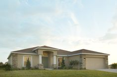 Remington II by Highland Homes. Click to view the home plan and for more info on this Florida new home! #dreamhomes