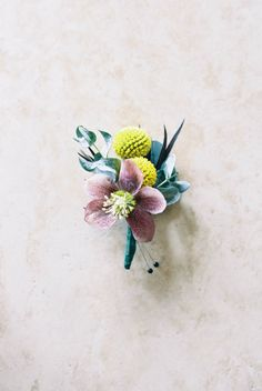 Hellebore and craspedia boutonniere:  http://www.stylemepretty.com/missouri-weddings/ste-genevieve-missouri/2016/10/05/rustic-romance-done-oh-so-right/ Photography: Laura Ann Miller - http://lauraannmiller.com/