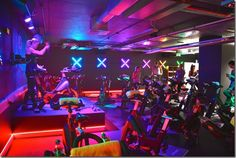 My Favorite London Spin Studio - My Healthy, Happier Life Gym Lighting, Reception Desk Design, Gym Interior, E Motion, Home Gym Design, Environmental Graphic Design, Gym Room, Outdoor Store, Fitness Studio