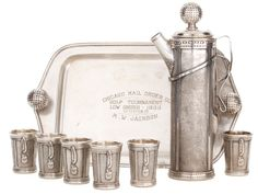 A GEORGE H. BERRY DESIGNED DERBY SILVER CO. SILVER PLATED GOLF-BAG FORM MARTINI PITCHER AND SIX CUPS WITH TRAY . Derby (Birmingham), Connecticut, circa 1926
