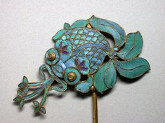Antique Chinese Kingfisher Hair Pin in the shape of a goldfish spewing water.