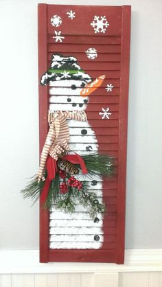 Reclaimed old wooden shutter One of a kind unique winter décor!!! Hand painted snowman with raised snowflake accents. Adorable scarf and