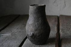Wabi-sabi terracotta vase. Wood fired pottery. Primitive